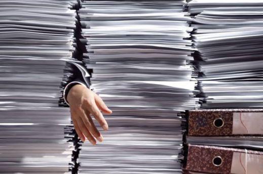 man-grabbing-papers