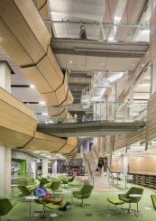 but-inside-the-library-a-dense-network-of-walkways-moving-walls-and-private-study-spaces-emphasizes-a-modern-design