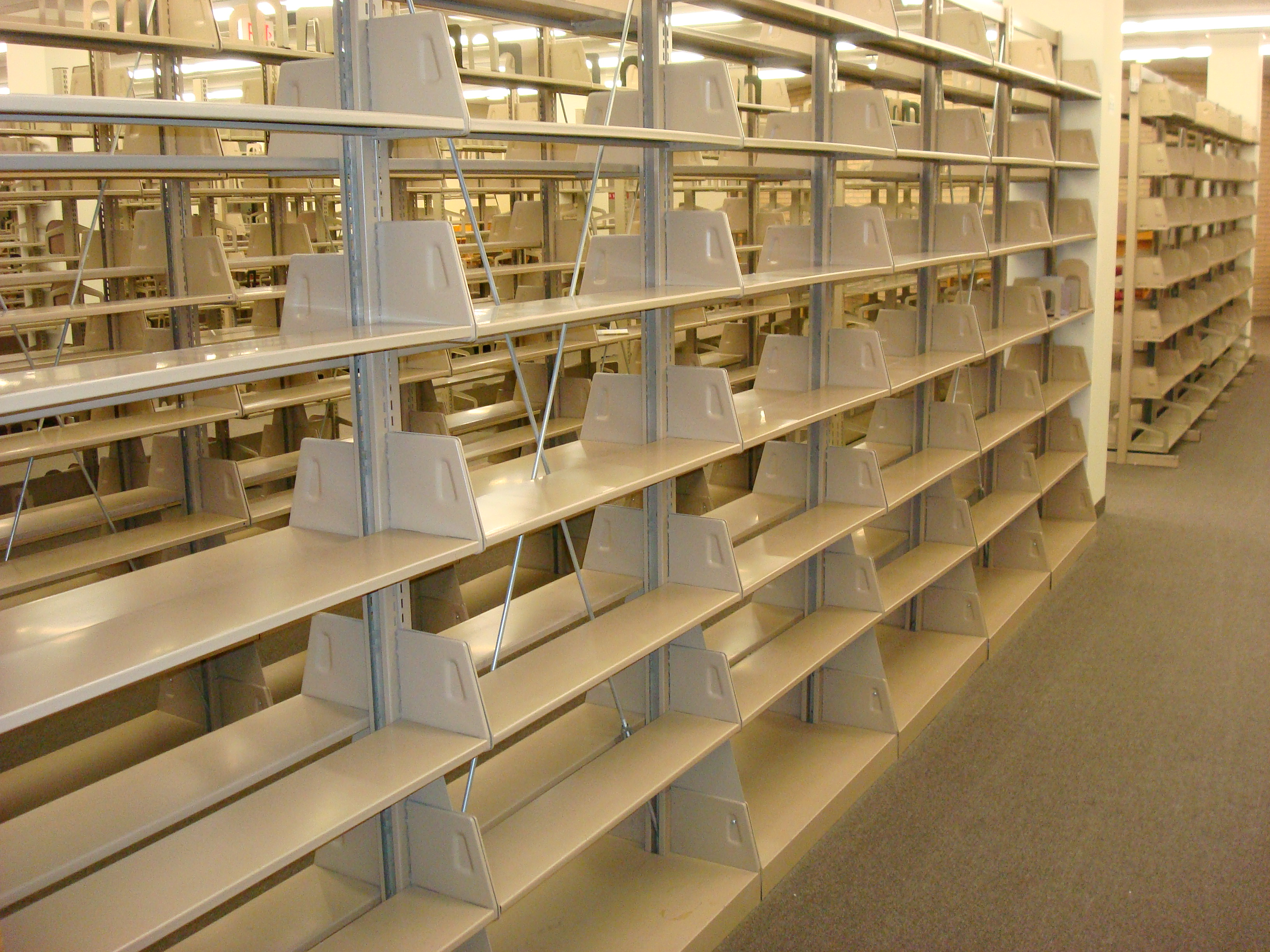 university libraries are questioning the added value of open shelves with books as scientific publications are increasingly available in electronic format - Library Bookshelves