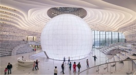 08-Tianjin Binhai Library, China-The new structure has a sleek futuristic design featuring a luminous spherical auditorium space in the center