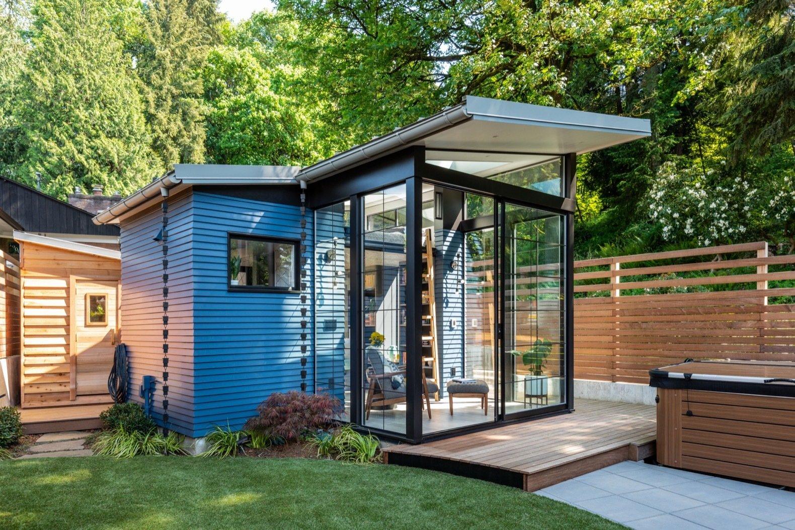 blue-painted-cedar-siding-wraps-around-the-169-square-foot