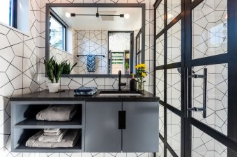 fire-clay-hexite-tile-covers-the-bathroom-walls-the-countertop-is-pental-quartz