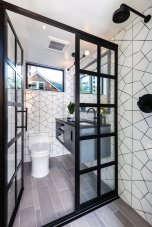 mullioned-doors-separate-the-vanity-from-the-indoor-shower-la-cantina-sea-foam-green-doors-not-pictured-connect-the-indoor-shower-to-an-outdoor-shower