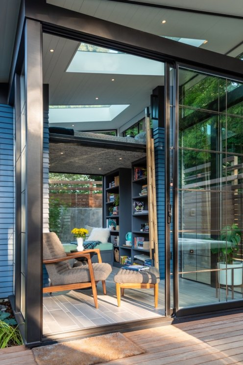 walls-of-glass-and-large-skylights-flood-the-interior-with-natural-light-and-frame-views-of-the-outdoors-the-windows-are-from-windorco-supply-inc