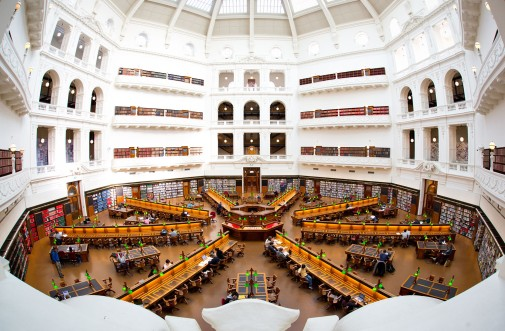 Visitors read in the La Trobe reading room in the State Library of Victoria in Melbourne, Australia, on July 3, 2014. The library holds more than 2 million books