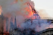 Mandatory Credit: Photo by IAN LANGSDON/EPA-EFE/Shutterstock (10205198b) The spire collapses while flames are burning the roof of the Notre-Dame Cathedral in Paris, France, 15 April 2019. A fire started in the late afternoon in one of the most visited monuments of the French capital. Cathedral of Notre-Dame of Paris on fire, France - 04 Jan 2019