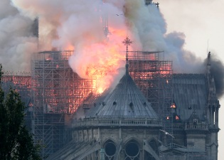 Mandatory Credit: Photo by IAN LANGSDON/EPA-EFE/REX/Shutterstock (10205136e) Flames on the roof of the Notre-Dame Cathedral in Paris, France, 15 April 2019. A fire started in the late afternoon in one of the most visited monuments of the French capital. Cathedral of Notre-Dame of Paris on fire, France - 15 Apr 2019