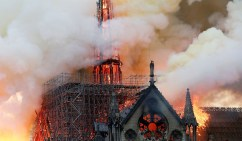 Smoke billows as fire engulfs the spire of Notre Dame Cathedral in Paris, France April 15, 2019. REUTERS/Benoit Tessier - RC1AC7F22C50