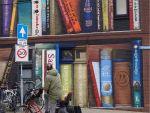 street-art-utrecht-apartment-building-transformed-into-bookcase-jan-is-de-man-5cadbddeed64a__700