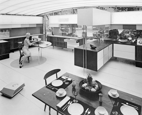 a-display-from-the-american-national-exhibition-in-moscow-1959-depicting-a-woman-in-the-miracle-kitchen-where-automation-has-reduced-her-domestic-workload