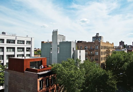 after-buying-adjacent-apartments-in-a-19th-century-tenement-building-in-brooklyn-alex-gil-and-claudia-desimio-created-a-multi-level-space-that-included-a-rooftop-addition-clad-in-cor-ten-steel-while-the-interior-is-b