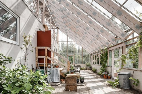 this-eco-friendly-a-frame-lakeside-home-in-the-swedish-city-of-gothenburg-was-designed-as-a-greenhouse-that-contains-a-three-bedroom-two-bath-residence-it-provides-the-family-with-apricots-tomatoes-kiwis-and-grapes-t