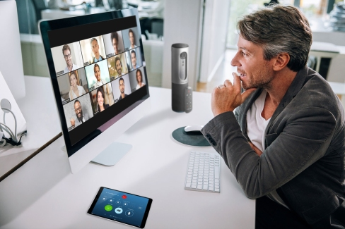 zoom_video_conferencing_online_meeting_remote_workers_one_user_connected_via_laptop_with_a_grid_of_twelve_participants_on_screen_2400x1600-100837446-large